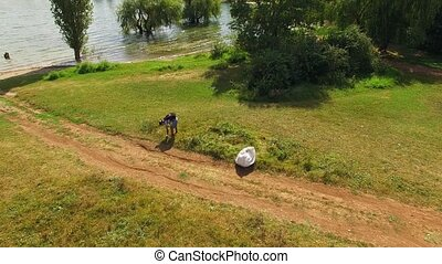 AERIAL VIEW. Young Man Cleaning Territory Of City Park From...