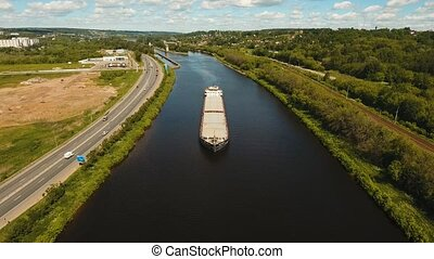Aerial view:Barge on the river.