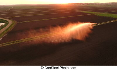 Aerial view:Irrigation system watering a farm field.