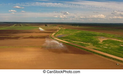 Aerial view:Irrigation system watering a farm field. -...