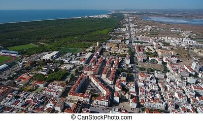 Aerial. Vila Real Santo Antonio and the Praia Verde on the...