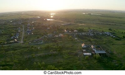 Aerial village view, summer video of town and green fields
