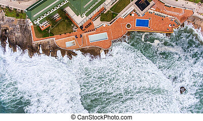 Aerial. Waves during a storm wash the shore Ericeira Portugal
