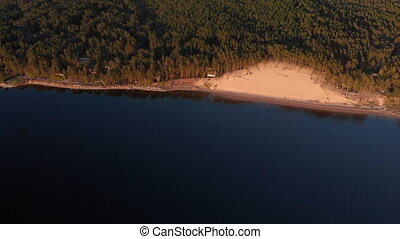 aerial white dune river pin Aerial White Dune on the river Lielupe in Varnukrogs - Golden Hour sunset top view from above - Drone shot with evergreen pine seaside forest visible in the background - Balta Kapa in European Latvia. - Cinematic professional panning with ND and PL filters used
