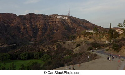 AERIAL: Wide Shot flying towards Hollywood Sign Letters at Sunset, Los Angeles, California 4K