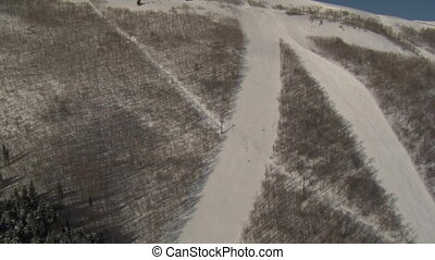 aerial wide shot of skiers carving