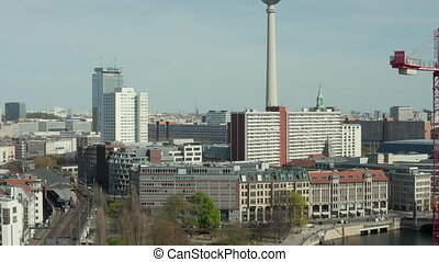 AERIAL: Wide View of Empty Berlin with Spree River and Train Tracks with View of Alexanderplatz TV Tower During COVID 19 Coronavirus HD