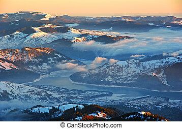 Aerial winter panorama over misty valley