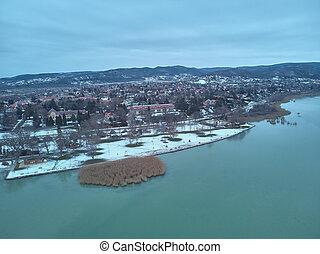 Aerial winter sunset landscape from a Hungarian village Balatongyorok, Lake Balaton in Hungary