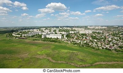 Aerial zoom in shot of the outskirts of Kherson with its...