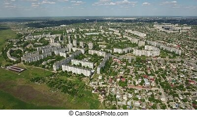 Aerial zoom out shot of Kherson city with its multistoreyed...