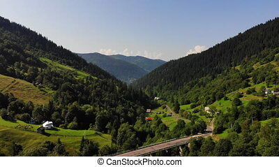 Aerial.Drone flies backward over stunning mountain...