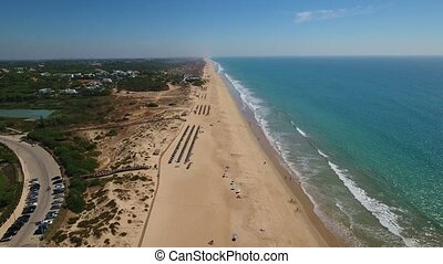Aeriaql. Beach Garrao with tourists filmed from the sky in Vale de Lobo