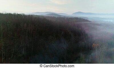 foggy autumn landscape with mountains - Aero shot on a foggy...