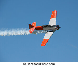 Aerobatic Demonstration - Aerobatic Plane with smoke trail. ...
