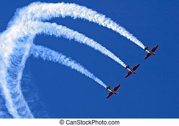 Aerobatic display - Three planes performing a synchronized...
