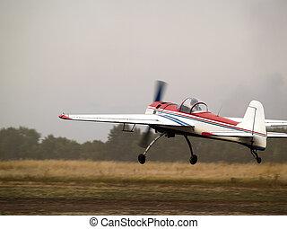 Aerobatic plane landing