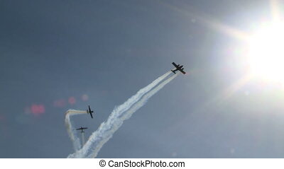 Aerobatics. Aircraft performing maneuvers in air -...
