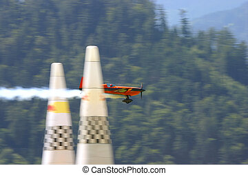 Aerobatics airplane racing - Aerobatics airplane reaching...