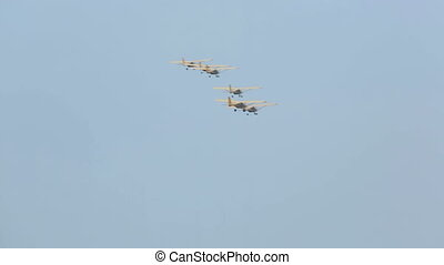 Aerobatics. - Group of light sport planes perform an...