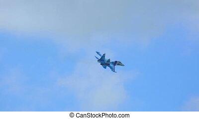 Aerobatics - Su-27 Sukhoi jet fighter performing aerobatic...