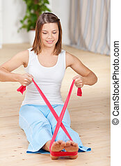 Aerobic exercise - Young woman doing aerobic exercise with ...