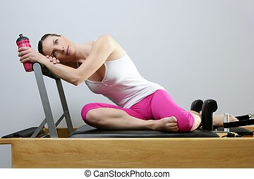 aerobic gym pilates woman rest holding water bottle