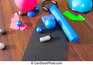 Aerobic Pilates stuff like mat balls roller magic ring rubber bands on wooden floor