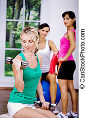 aerobics girls - young women at aerobics training in the gym