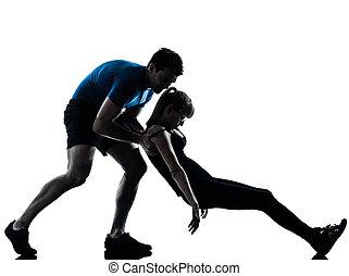 aerobics intstructor with mature woman exercising