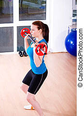aerobics - Young women exercising in a step aerobics class