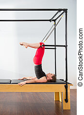 Aerobics pilates instructor woman in cadillac fitness...
