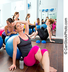 Aerobics pilates women group having a rest at gym