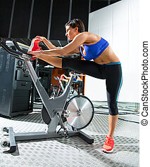Aerobics spinning monitor trainer woman stretching exercises...