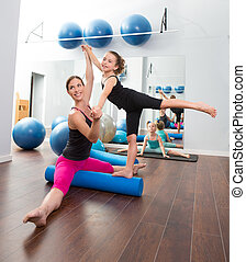 Aerobics woman personal trainer of children girl stability ...