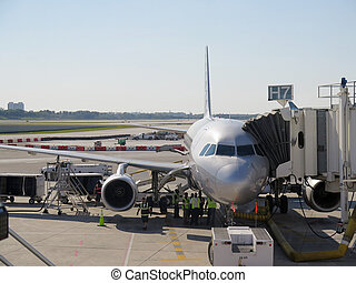 Aerobridge in plane parked in the airport waiting for passengers