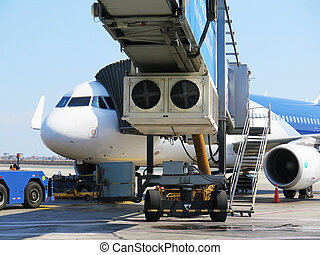 Aerobridge in plane parked in the airport waiting for...