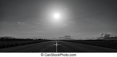 Aerodrome runway back light with mountains in the background...