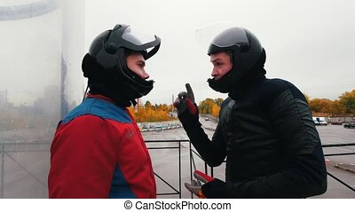 Aerodynamic tube. Instructor explaining the person how to...