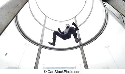 Aerodynamic tube. The wind lifts up the person highly. Slow...