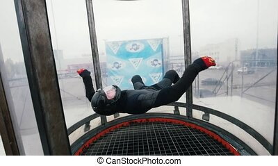 Aerodynamic tube. The wind lifts up the person in the tube