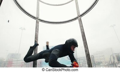 Aerodynamic tube. The wind lifts up the person up and down -...