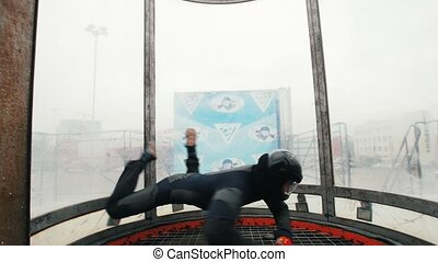 Aerodynamic tube. The wind lifts up the person up and down...