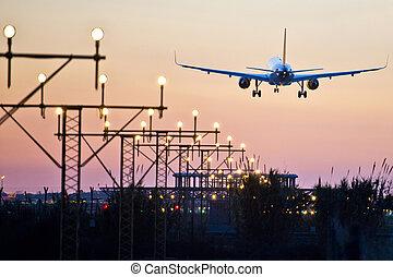 Aeroplane landing with sunset