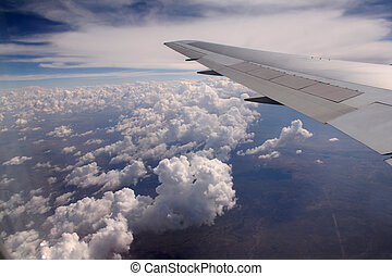 Aeroplane wing - The wing of an aeroplane flying high over ...