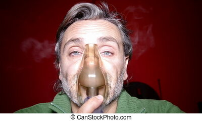 aerosol therapy - Medical inhalation Man with mask on his...