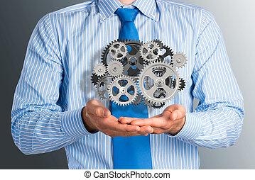affärsman, fästen, uppe, a, mekanism, av, utrustar