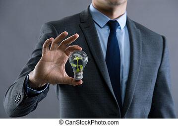 affärsman, holdingen, lampa, in, grön, miljö, begrepp