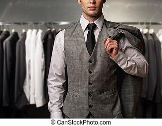 affärsman, in, klassisk, undertröja, mot, rad, av, kostymen,...