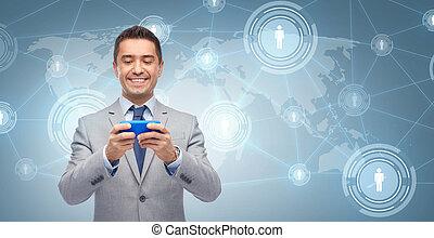 affärsman, meddelande, smartphone, texting, lycklig